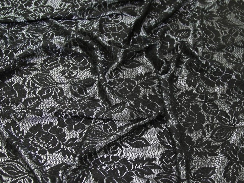 7ae37fc89ec The lace is an open weave with a luscious silver background. It looks  different when cut at different angles and has a different backing.